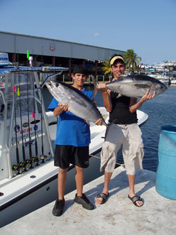 Father and son with a pair of blackfin tunas